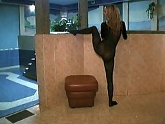 Damn! The nasty blonde in pantyhose lingerie is lustful enough to spread the legs and stick the dildo inside burning pussy through the hole in her wonderful outfit. voyeur video #3