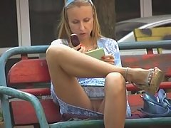 Voyeur upskirt pussy of filthy blonde amateur making a phone call on the bench voyeur video #1