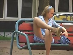 Voyeur upskirt pussy of filthy blonde amateur making a phone call on the bench voyeur video #2