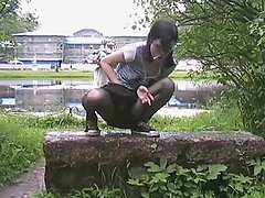 Sassy gal on her hunkers with hand petting pussy inside black pantyhose voyeur video #2