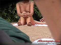 Handsome guy and his luxurious blonde girlfriend are sunbathing without clothes on nude beach voyeur video #4