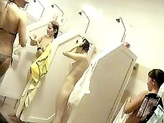 All the cabins in a washing house are full of nude sexy ladies. What a show!! voyeur video #2