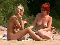 Stunning blonde and gorgeous redhead basking in the sun absolutely naked voyeur video #1