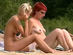Stunning blonde and gorgeous redhead basking in the sun absolutely naked voyeur video #2
