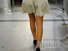 Bronzed beauty with posh trotters! I was in no hurry, slowly followed her to the escalator in anticipation of her charms for my girl upskirt movies! Beautiful shaved crotch in white panties! Round suntanned booty on close-up street upskirt shots! An excel voyeur video #1